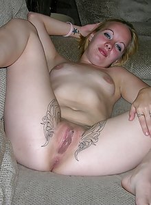Inked naked girls spread pussy